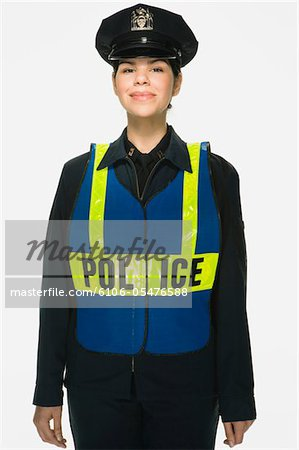 Traffic police officer on white background, portrait Stock Photo - Premium Royalty-Free, Image code: 6106-05476588