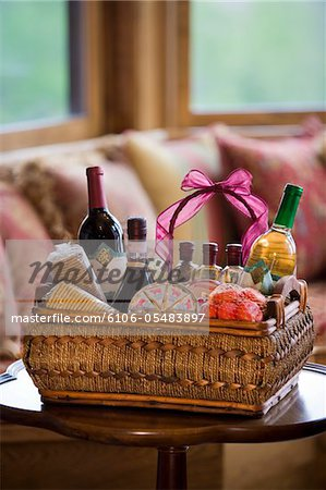 Wine bottles in basket at home Stock Photo - Premium Royalty-Free, Image code: 6106-05483897