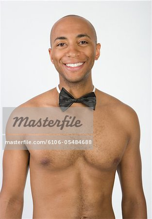 Young man wearing bow tie, portrait Stock Photo - Premium Royalty-Free, Image code: 6106-05484688