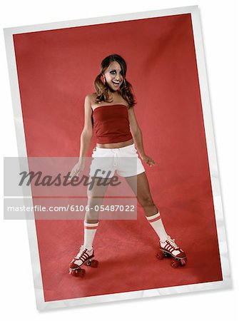 A wrinkled and faded photograph of a 70's fashion model wearing roller skates. Stock Photo - Premium Royalty-Free, Image code: 6106-05487022