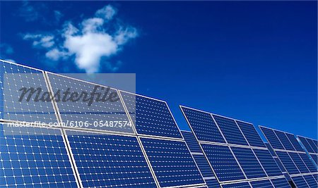 Rows of Solar Panel under clear sky. Stock Photo - Premium Royalty-Free, Image code: 6106-05487574