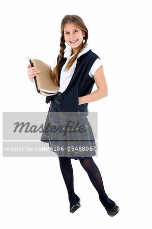 Girl with textbooks. Stock Photo - Premium Royalty-Free, Image code: 6106-05488057
