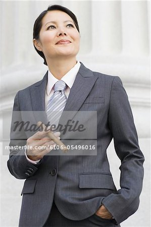 Asian Businesswoman with Cigar Stock Photo - Premium Royalty-Free, Image code: 6106-05496016