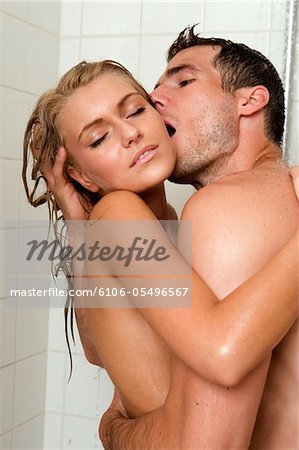 Young couple embracing in shower Stock Photo - Premium Royalty-Free, Image code: 6106-05496567