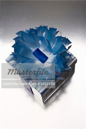Gifts wrapped in blue and silver paper decorated with flower Stock Photo - Premium Royalty-Free, Image code: 6106-05502062