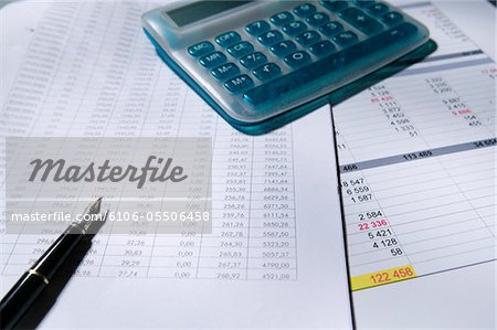 Calculator and fountain pen on spreadsheet, elevated view Stock Photo - Premium Royalty-Free, Image code: 6106-05506458