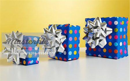 Three gift boxes with bows Stock Photo - Premium Royalty-Free, Image code: 6106-05508270