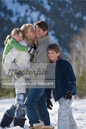 Family with two children (8-10) in mountains Stock Photo - Premium Royalty-Free, Image code: 6106-05511874