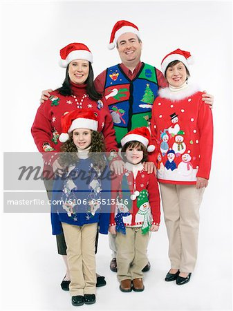 Family with children (4-7) wearing Christmas sweaters and santa hats, portrait Stock Photo - Premium Royalty-Free, Image code: 6106-05513116