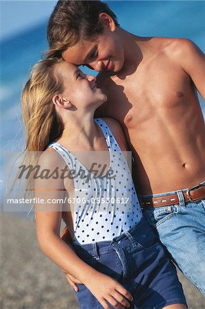 Girl and boy (8-11) on beach Stock Photo - Premium Royalty-Free, Image code: 6106-05530617