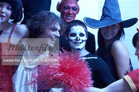 Group of people dressed for Halloween, smiling, portrait Stock Photo - Premium Royalty-Free, Image code: 6106-05538394