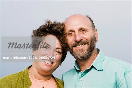 Mature couple smiling, portrait, close-up Stock Photo - Premium Royalty-Free, Image code: 6106-05539724