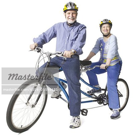 Elderly caucasian couple rest on a tandem bike. Stock Photo - Premium Royalty-Free, Image code: 6106-05598631