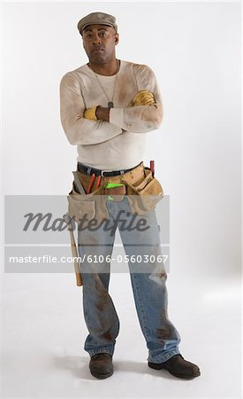 Afro-American carpenter Stock Photo - Premium Royalty-Free, Image code: 6106-05603067