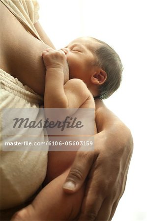 Baby with mom Stock Photo - Premium Royalty-Free, Image code: 6106-05603159