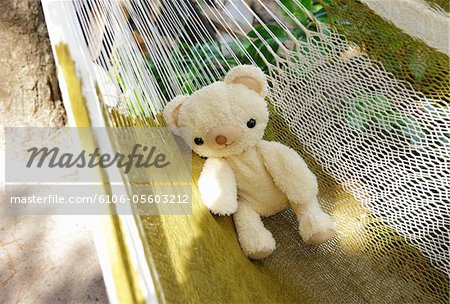 Teddy bear on hammock Stock Photo - Premium Royalty-Free, Image code: 6106-05603212