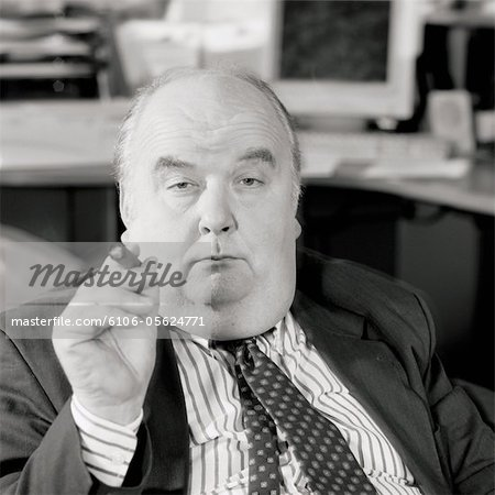 Mature businessman holding cigar, portrait (B&W) Stock Photo - Premium Royalty-Free, Image code: 6106-05624771