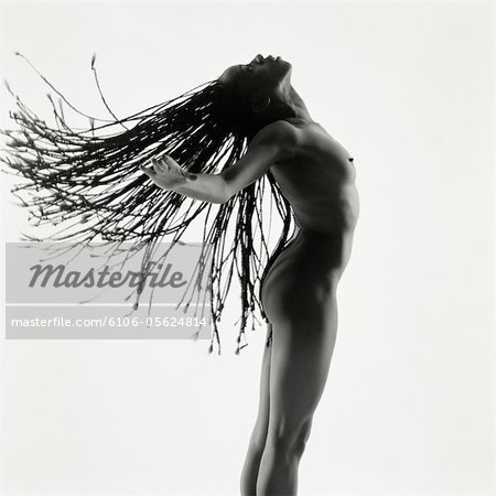Profile of a Nude Woman Tossing Her Hair Stock Photo - Premium Royalty-Free, Image code: 6106-05624814