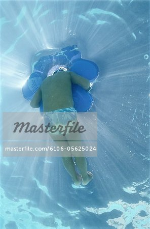Underwater View of Child in Swimming Pool Stock Photo - Premium Royalty-Free, Image code: 6106-05625024