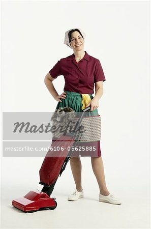 Maid with a Vacuum Stock Photo - Premium Royalty-Free, Image code: 6106-05625885