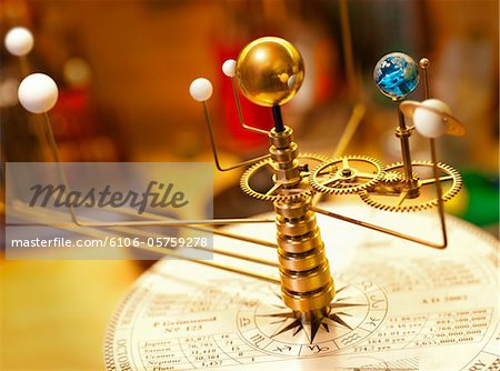 Planets orbit the sun on an Orrery. Stock Photo - Premium Royalty-Free, Image code: 6106-05759278