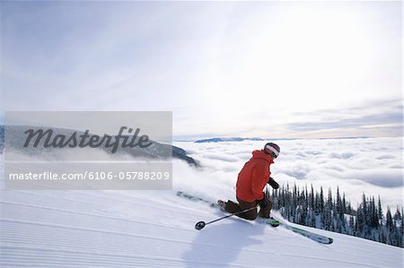 Telemark skier skis freshly groomed ski trail Stock Photo - Premium Royalty-Free, Image code: 6106-05788209
