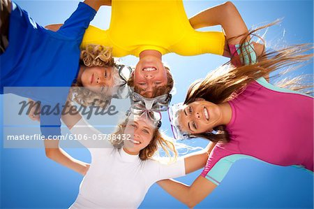 Young kids smiling in the sun with snorkel goggles Stock Photo - Premium Royalty-Free, Image code: 6106-05788432