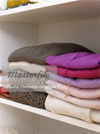 Sweaters and knit wear on closet shelf. Stock Photo - Premium Royalty-Free, Image code: 6106-05810544