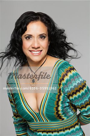 Smiling portrait of hispanic woman Stock Photo - Premium Royalty-Free, Image code: 6106-05951962