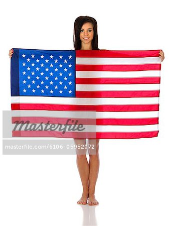 American Woman Showing Her Flag Proudly Stock Photo - Premium Royalty-Free, Image code: 6106-05952072