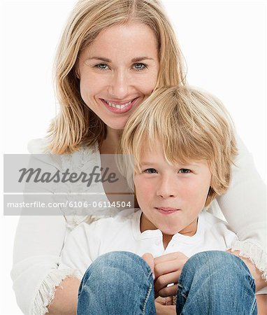 Portrait of mother and son, smiling Stock Photo - Premium Royalty-Free, Image code: 6106-06114504