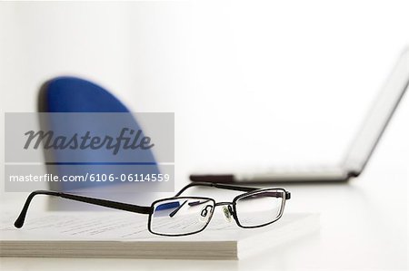 glasses on table in office Stock Photo - Premium Royalty-Free, Image code: 6106-06114559