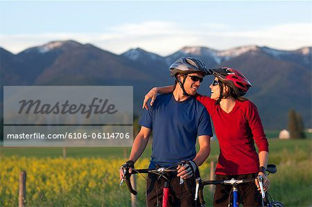 Cyclist couple share a laugh Stock Photo - Premium Royalty-Free, Image code: 6106-06114706