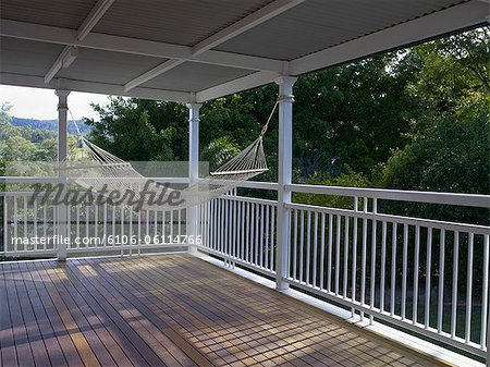 Hammock hanging in verandah with view. Stock Photo - Premium Royalty-Free, Image code: 6106-06114766