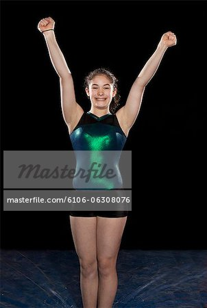 young gymnast with hands in the air Stock Photo - Premium Royalty-Free, Image code: 6106-06308076