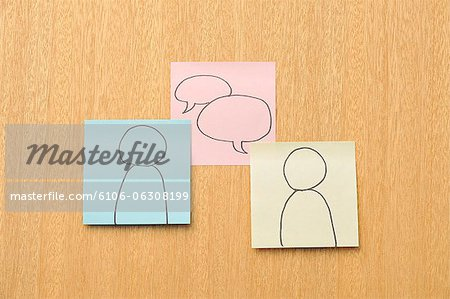 Post-it note to draw a mark Stock Photo - Premium Royalty-Free, Image code: 6106-06308199