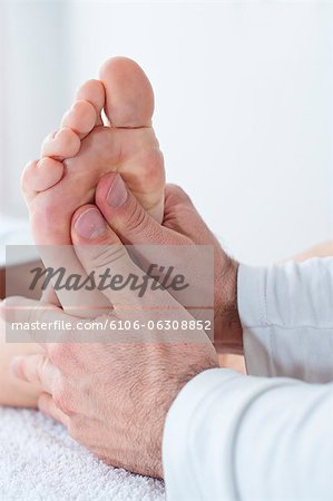 Physiotherapist at work Stock Photo - Premium Royalty-Free, Image code: 6106-06308852