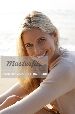 portrait of woman on beach Stock Photo - Premium Royalty-Free, Image code: 6106-06309486