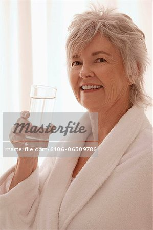 Older woman drinking water. Stock Photo - Premium Royalty-Free, Image code: 6106-06309786