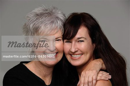 mother and daughter hugging eachother Stock Photo - Premium Royalty-Free, Image code: 6106-06309841