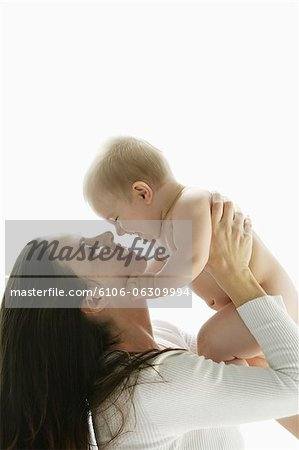 mother and baby looking at each other Stock Photo - Premium Royalty-Free, Image code: 6106-06309994