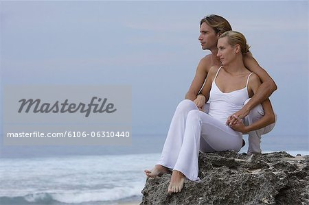 couple on rocks on seashore Stock Photo - Premium Royalty-Free, Image code: 6106-06310440