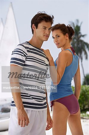 Young couple in front of sail boat Stock Photo - Premium Royalty-Free, Image code: 6106-06310791