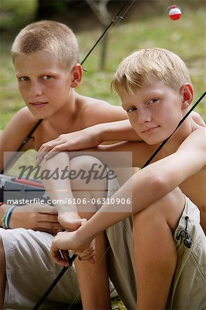 young boys with fishing gear Stock Photo - Premium Royalty-Free, Image code: 6106-06310906