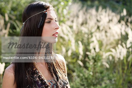 Profile of young woman with brown hair and headband Stock Photo - Premium Royalty-Free, Image code: 6106-06311191