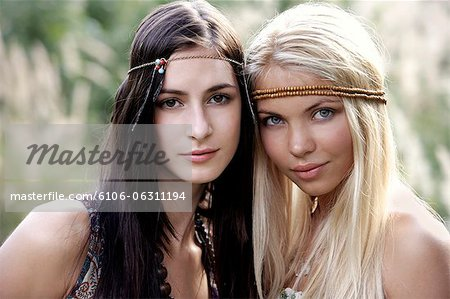 Two young hippie chicks Stock Photo - Premium Royalty-Free, Image code: 6106-06311194