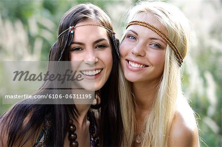 Two young hippie chicks Stock Photo - Premium Royalty-Free, Image code: 6106-06311195