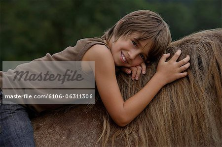boy on horseback Stock Photo - Premium Royalty-Free, Image code: 6106-06311306