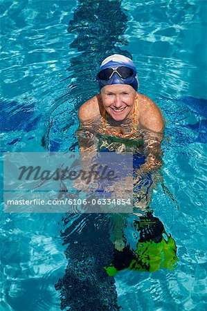Mature woman excercising in pool Stock Photo - Premium Royalty-Free, Image code: 6106-06334854