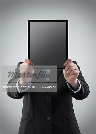 Businesswoman holding a digital tablet Stock Photo - Premium Royalty-Free, Image code: 6106-06334977
